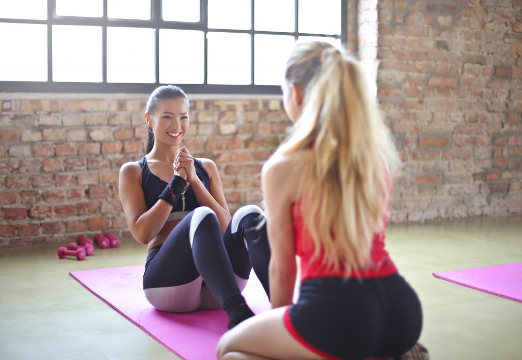 woman-with-red-top-and-black-shorts-on-purple-yoga-mat-866019 (1)